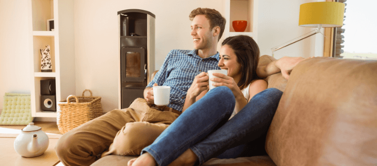 couple drinking coffee in new home