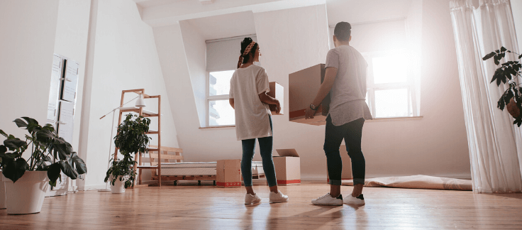 man and woman moving into their first home