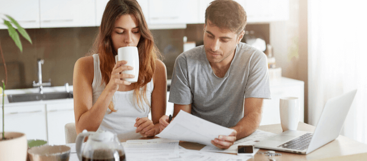 Man and woman looking at loan comparisons