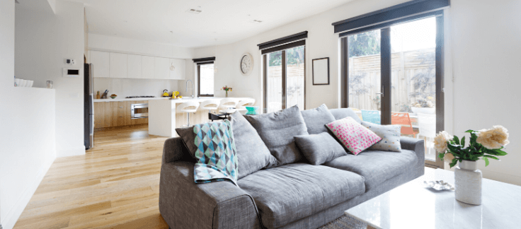 A bright open plan living room and kitchen area in an investment property