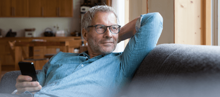 man on couch thinking about refinancing