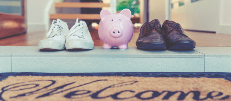 piggy bank and shoes on doormat
